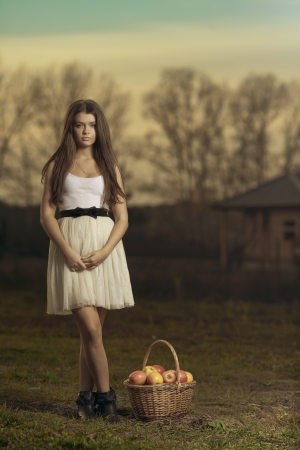 young woman with aplle basket outdoor  photo