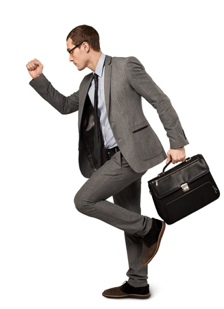 gray suit: Man in a business suit with suitcase isolated