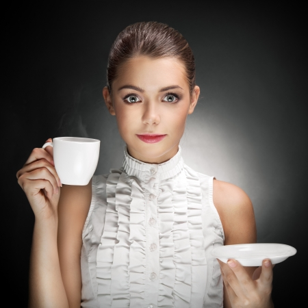Beautiful Woman Drinking Coffee.  photo