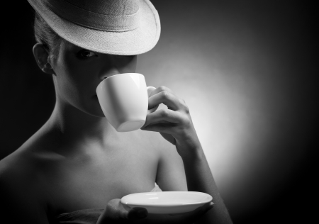 Beautiful Woman Drinking Coffee. Space for text  photo