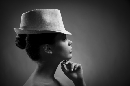 Silhouette of elegant lady in hat. BW Image photo