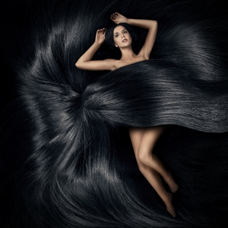 black women naked: Beautiful woman lying on the hair and cover her body Stock Photo