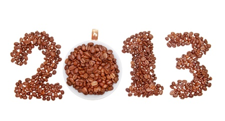 New Year 2013 made of coffee beans and cup on the white background  photo