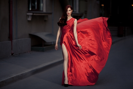 fluttering: Young Beauty Famous Woman In Fluttering Red Dress Outdoor