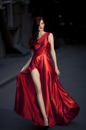famous women: Young Beauty Famous Woman In Red Dress Outdoor Stock Photo