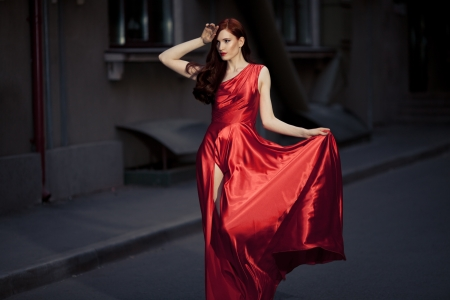 Young Beauty Famous Woman In Red Dress Outdoor Stock Photo - 16732206