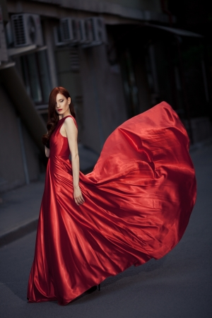 woman red dress: Young Beauty Famous Woman In Red Dress Outdoor Stock Photo