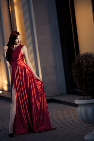 Young Beauty Famous Woman In Red Dress Outdoor Stock Photo - 16732193