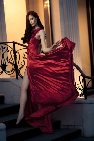 flyaway: Young Beauty Famous Woman In Red Dress Outdoor Stock Photo