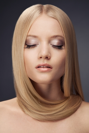 Fashion Blond Girl. Beautiful Makeup and Healthy Hair photo