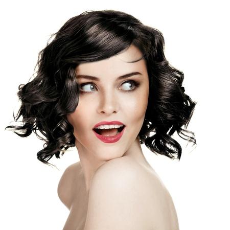 Hermosa mujer sonriente Retrato En El Fondo Blanco Foto de archivo