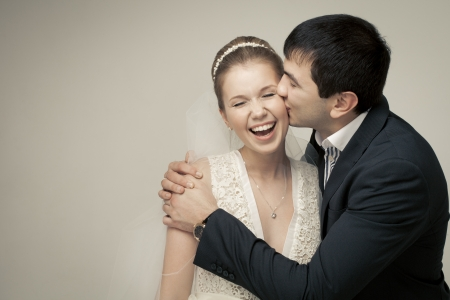 gentle couple of lovers groom and bride. studio shooting at white background photo