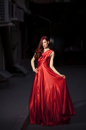 Young Beauty Famous Woman In Red Dress Outdoor Stock Photo - 16732203