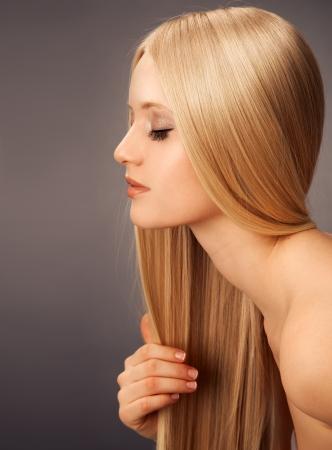 capelli biondi: Donna Bionda Hair.Beautiful con capelli lisci lunghi Archivio Fotografico