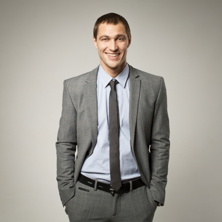 Cool businessman portrait on grey background Stock Photo - 16764496