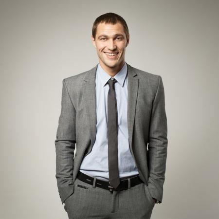 podnikatel: Cool podnikatel portrét na šedém pozadí Reklamní fotografie