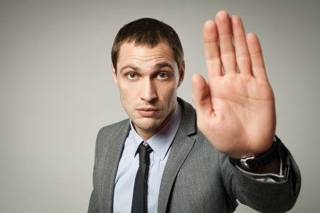 a young businessman showing stop gesture photo