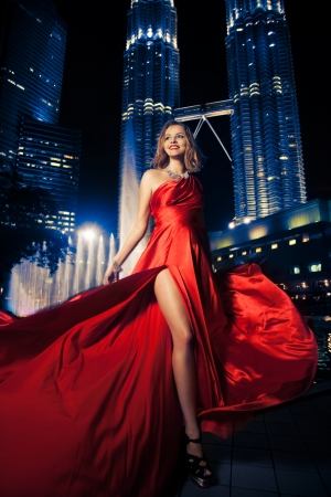 flyaway: Fashion Lady In Red Dress And City Lights