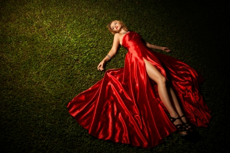 red shoes: Beautiful Lady In Red Dress Lying On Green Grass