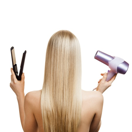 long blonde hair: Blonde hair and hairdressers tools Stock Photo