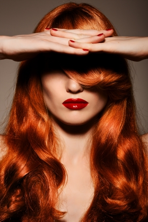 wavy hair: Beautiful Redhair Girl.Healthy Curly Hair. Stock Photo