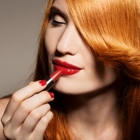 Close-up portrait of beautiful woman with red lipstick Stock Photo - 17799837