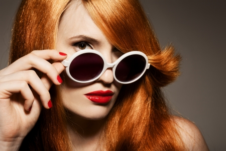 Beautiful woman with bright make-up and sunglasses photo