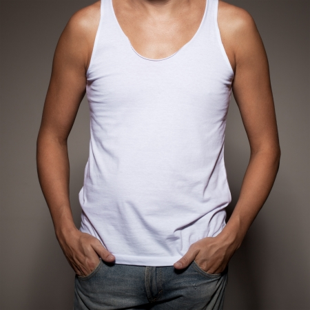 undershirt: White t-shirt on a young man template on gray background