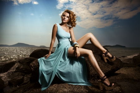 Portrait Of Fashion Woman In Blue Dress Outdoor  photo