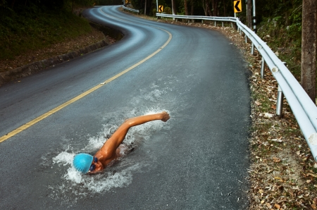 sportsman: Strong Man Swim On Asphalt Road Stock Photo
