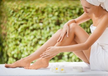 Beautiful Woman Legs And Cream. Stock Photo - 17934808
