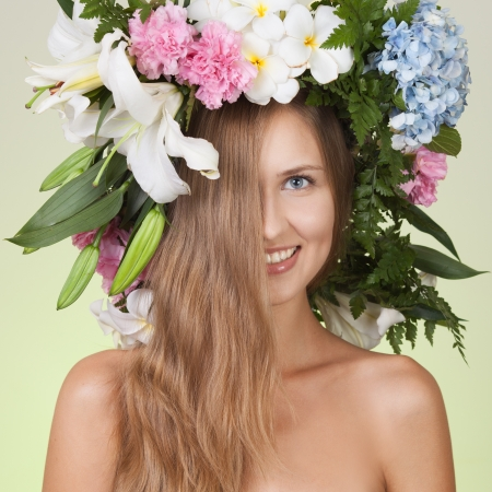 beauty woman portrait with wreath from flowers on head photo