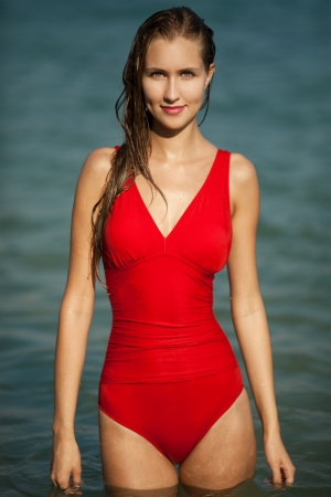 Beautiful woman in red bikini at sea photo