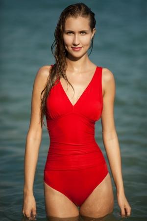 Beautiful woman in red bikini at sea Stock Photo - 18711323