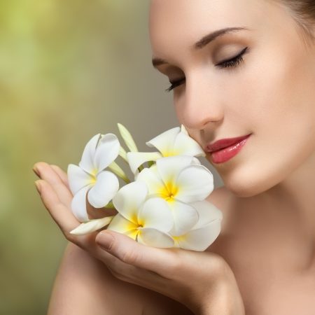 Beauty face of the young beautiful woman with flower. photo