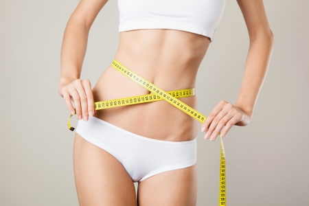 허리의 잘룩 한 선: Woman measuring her waistline. Perfect Slim Body. Diet