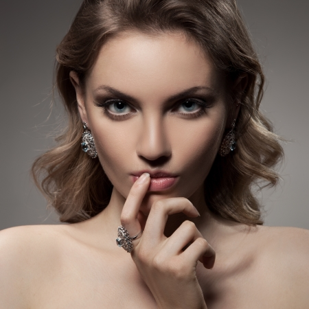 Fashion Portrait Of Beautiful Luxury Woman With Jewelry  photo
