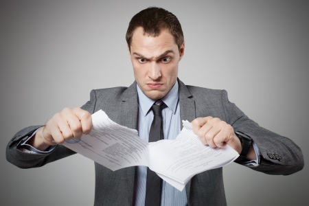 Businessman tearing contract photo