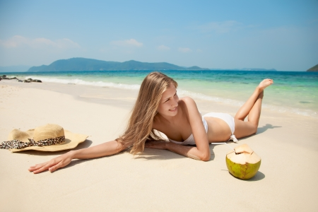 Young Woman Relaxing At Tropical Beach photo