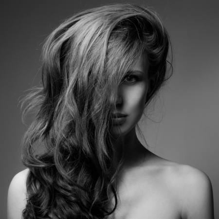 Fashion Portrait Of Beautiful Woman. Curly Long Hair. BW Image photo