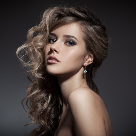 Beautiful Blond Woman. Curly Long Hair photo