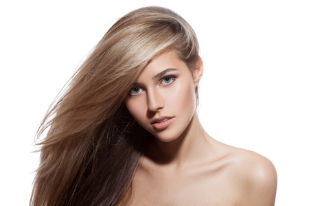 Beautiful Blond Girl. Healthy Long Hair. White Background photo
