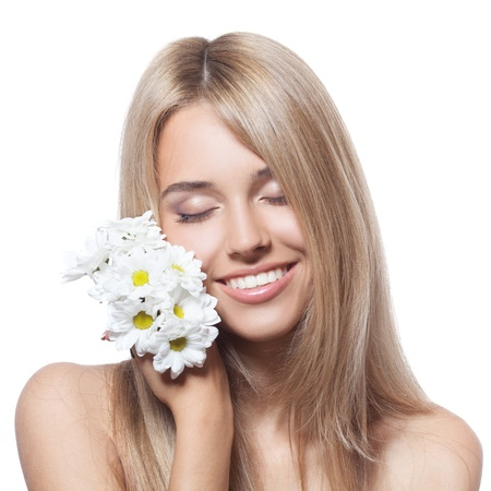 Beautiful happy young woman with flowers photo