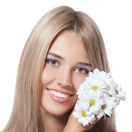 Beautiful happy young woman with flowers Stock Photo - 20836578