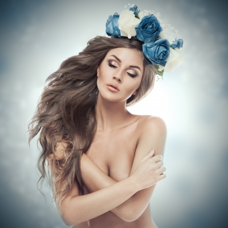 Beautiful Woman With Flower Wreath. Stock Photo - 22012219