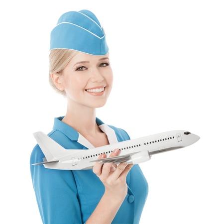 손에 매력적인 스튜어디스 지주 비행기. 흰색 배경에 고립입니다. 스톡 콘텐츠