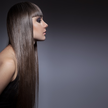 grey hair female: Portrait of a beautiful brunette woman with long straight hair  Stock Photo