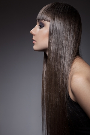 Portrait of a beautiful brunette woman with long straight hair  Фото со стока