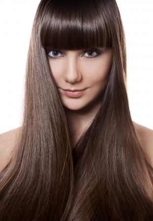 long straight hair: Portrait of a beautiful brunette woman with long straight hair  Stock Photo