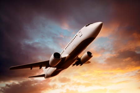 jetliner: Airplane in the sky at sunset